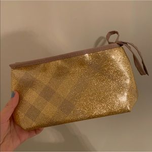 Burberry gold shiny pouch